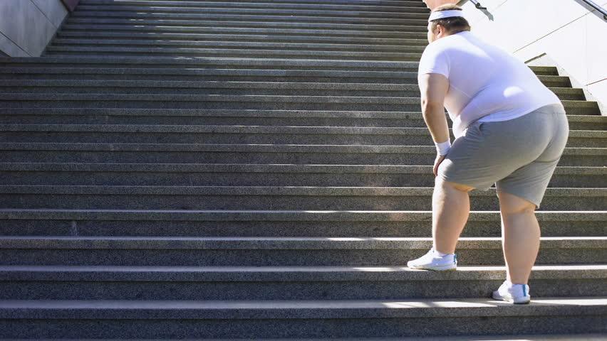 uomo grasso scale